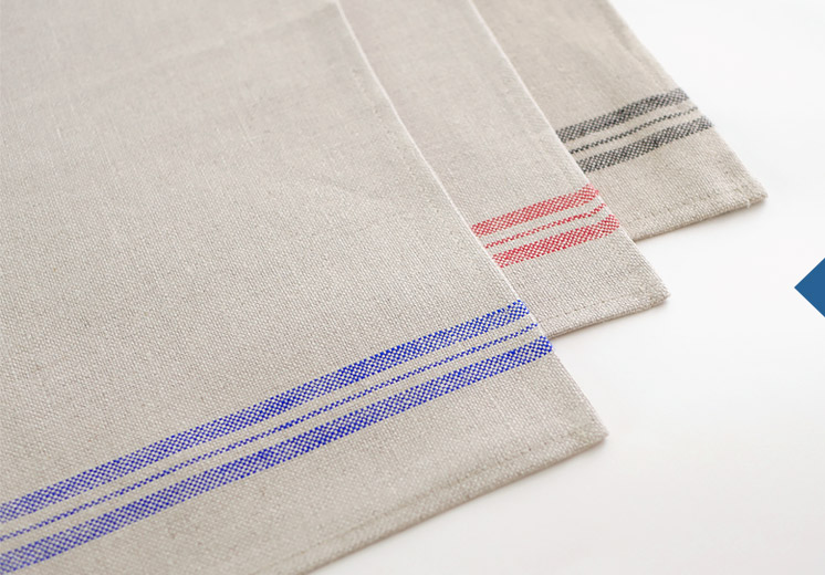 Three linen tea towels with blue, red and black stripes
